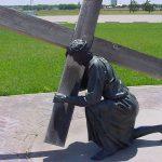 Jesus carrying cross - sculpture