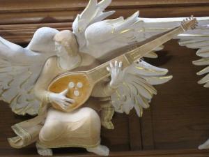 Bath Abbey angel with sitar -- photo by Ana Gobledale