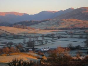 Windermere sunrise, Cumbria UK -- photo by Ana Gobledale